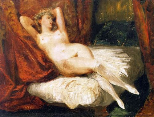 female-nude-reclining-on-a-divan