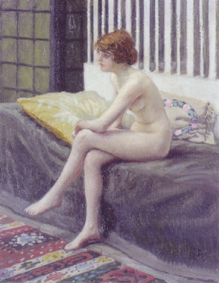 Young Model Resting Seated On The Bed