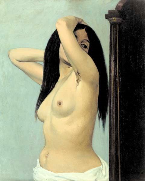 Femme nue regardant dans une psychée