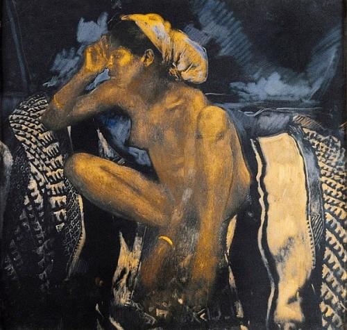 Jeune femme assise sur une couverture noire et blanche