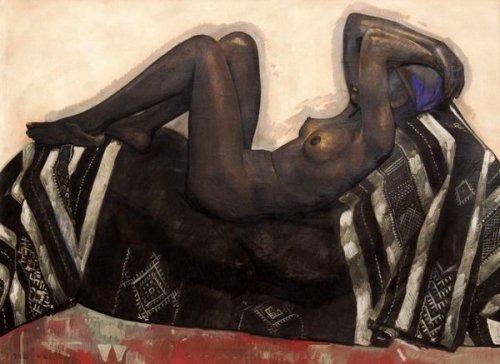 Keltoum - Fatima sur un tapis berbère