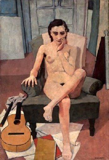 Donna seduta con chitarra