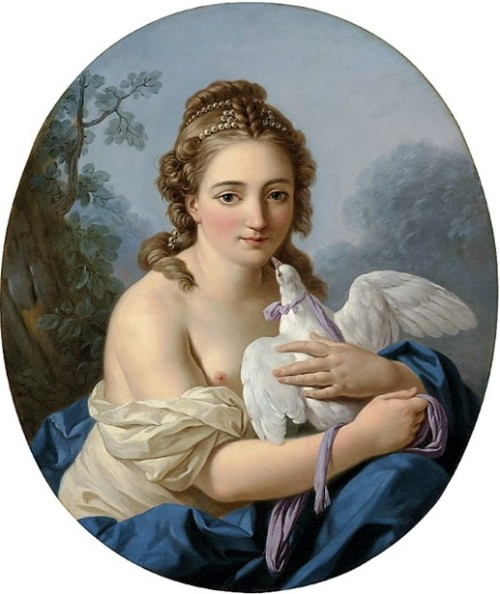 A Young Woman Holding A Dove