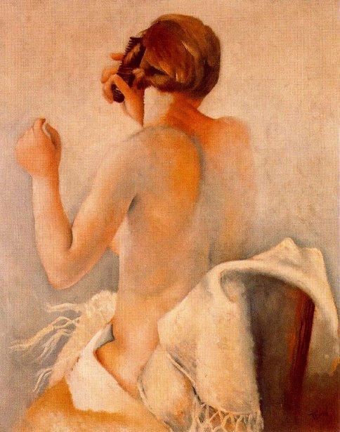 Mujer peinándose