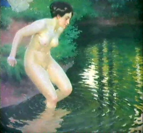 Woman Dipping In Wooded Lake