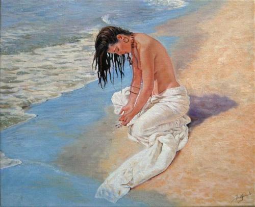 Mujer con rasstas en la playa