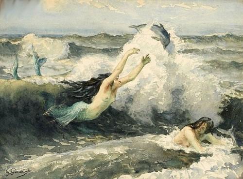 Sirènes jouant dans les vagues